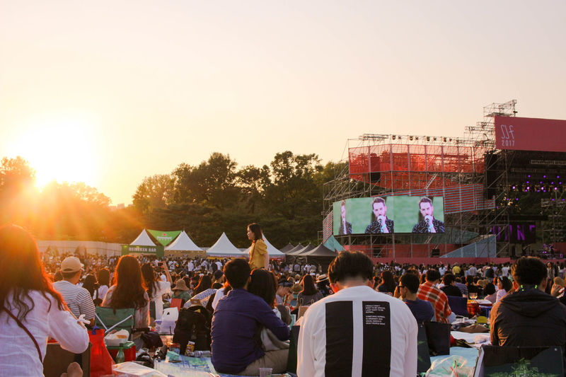 Arts Culture And Entertainment Audience Building Exterior Clear Sky Crowd Day Enjoyment Event Fun Fé Large Group Of People Leisure Activity Lifestyles Men Music Music Festival Musician Outdoors People Performance Popular Music Concert Real People Sky Togetherness Women