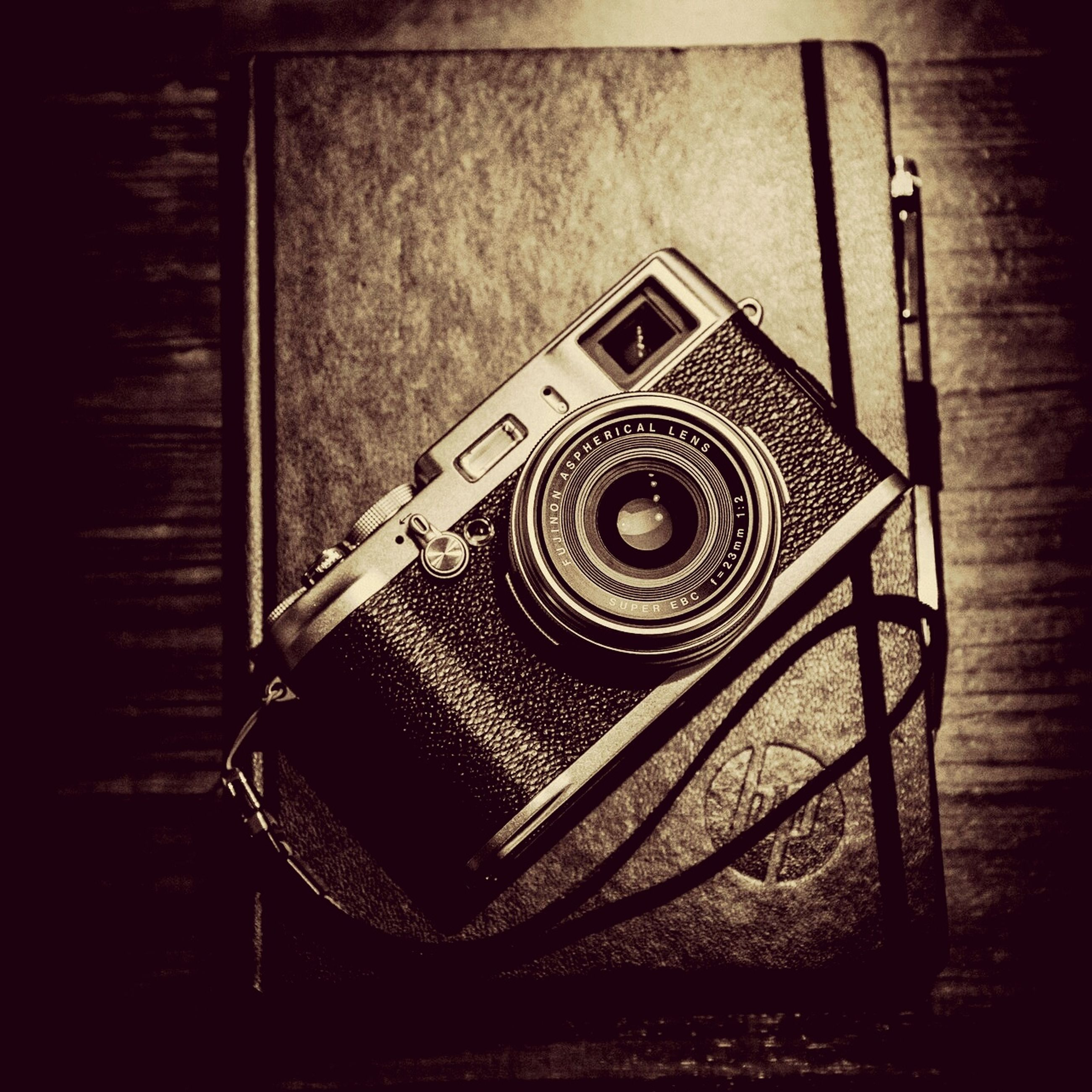 indoors, still life, retro styled, old-fashioned, close-up, table, antique, technology, old, single object, wood - material, metal, no people, high angle view, wall - building feature, auto post production filter, vintage, telephone, man made object, black color