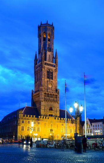"""Market Place with """"Belfried"""" The Great Outdoors With Adobe Light And Shadow Cities At Night Eyeem Awards 2016 Brugge Belgium Belgium The Week Of Eyeem Evening Nikonphotography Buildings Night Cities At Night"""