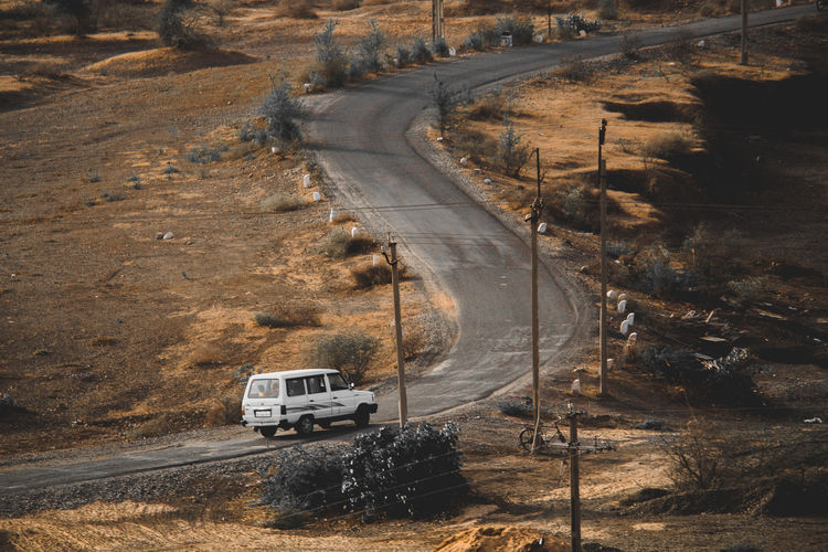 Arid Climate Car Climate Country Road Day Direction Environment High Angle View Land Land Vehicle Landscape Mode Of Transportation Motion Motor Vehicle Nature No People Non-urban Scene Outdoors Road Road Trip Street Transportation Travel The Traveler - 2018 EyeEm Awards The Great Outdoors - 2018 EyeEm Awards