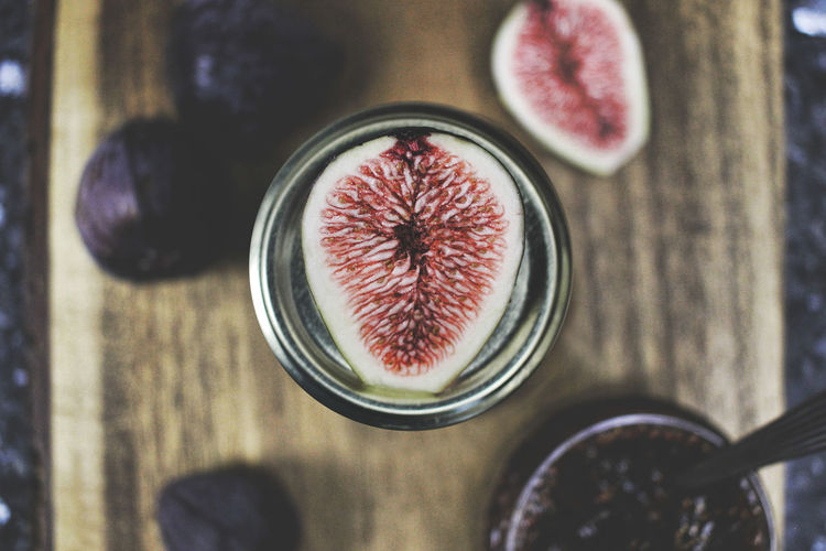 Directly above shot of halved fig in jar