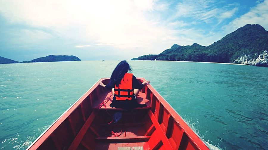 Freshness Outdoors Mountain Beauty In Nature Sea Real People Nautical Vessel Sky Scenics Day Nature One Person Water People Beach Boat Ship On The Way Vacations Summer Safety Happy People Traveller Traveling