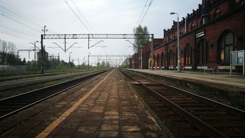 Railroad Track Rail Transportation Cable Railroad Station No People Electricity  Sky Electricity Pylon Outdoors Day