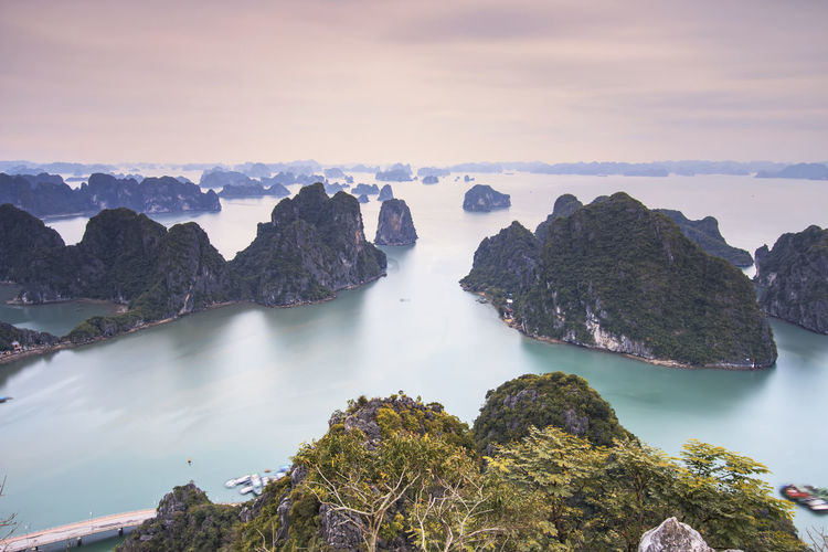 Scenic View Of Rock Formations In Halong Bay Against Sky