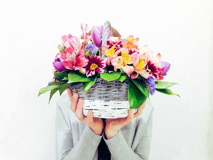 Young girl is holding basket with flowers Handsinframe Hands Womanhands Greyclothes Girl Woman Womansday Womanstyle Basket Alstroemeria Tulips Tulip Flowerbasket Flowers Floral Florals Flower Bouquet Portrait Front View Multi Colored Close-up Flower Head Petal Bunch Of Flowers Pink
