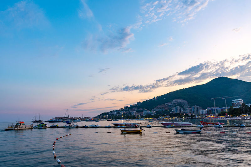 View of boats in marina at sunset