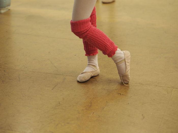 Low Section Of Ballet Dancer Dancing On Floor