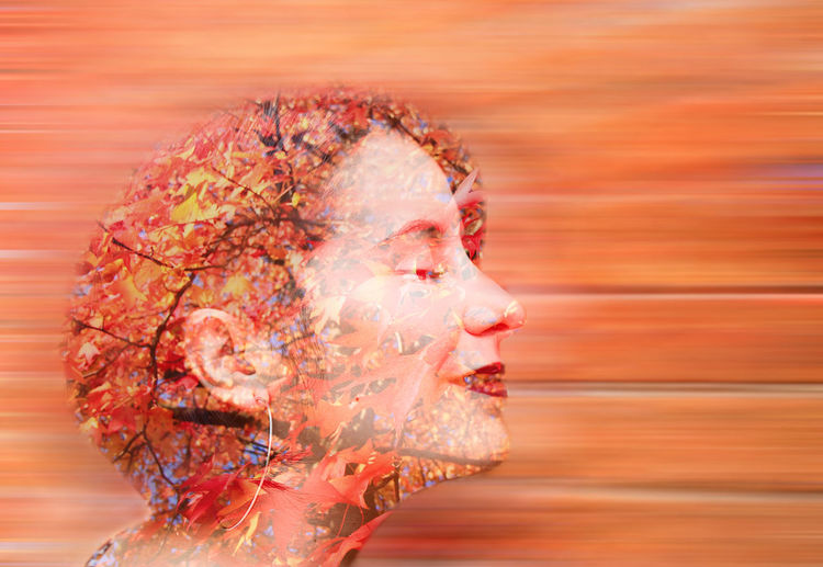 Digital composite image of human face against sunset sky
