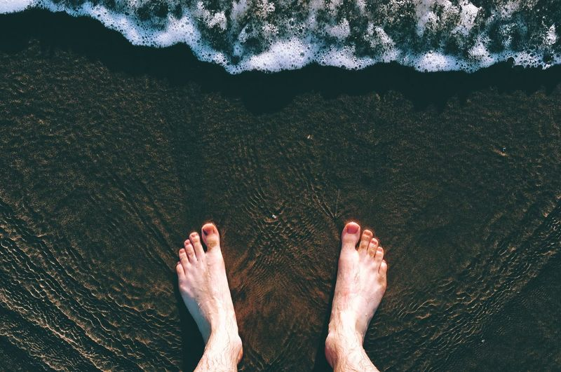 Low section of man in sea