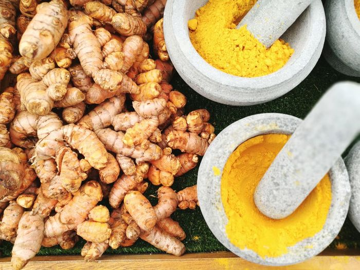 Directly Above Shot Of Ginger With Turmeric In Mortar