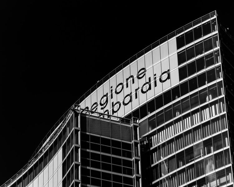 Milan,Italy Architecture Blackandwhite Photography Building Building Exterior Built Structure City Clear Sky Communication Copy Space Glass - Material Illuminated Low Angle View Milanocity Modern Nature Night No People Office Building Exterior Outdoors Sign Sky Text Western Script