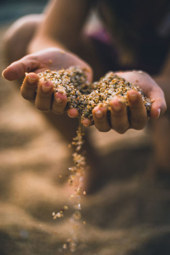 falling sand from hands Body Part Close-up Day Finger Focus On Foreground Food Food And Drink Hand Hands Cupped Holding Human Body Part Human Finger Human Hand Land Nature One Person Outdoors Real People Sand Selective Focus