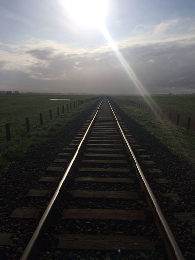 Betterlandscapes Landscape Betterlandscapes Landscape Rail Transportation Sky Sun Diminishing Perspective Direction Track Sunlight Railroad Track vanishing point Nature The Way Forward Lens Flare No People Cloud - Sky Transportation Environment Sunbeam Day Outdoors