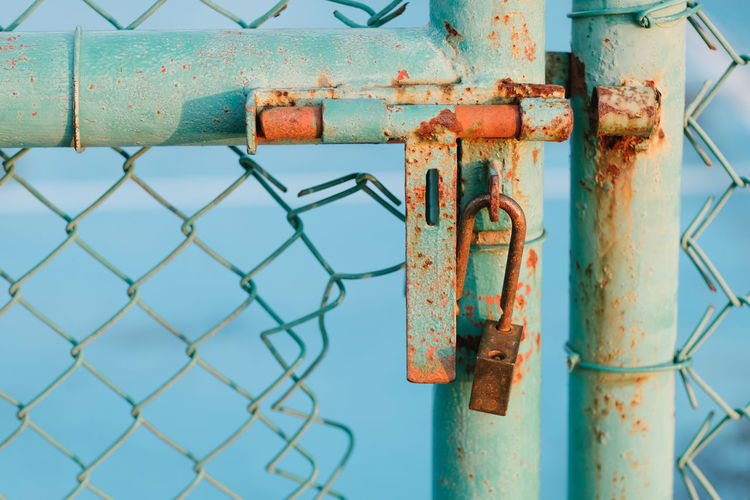 Close-Up Of Rusty Padlock On Gate