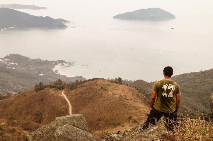 Adventure Beauty In Nature Down Height Hike Hiking HongKong Landscape Lantau Island Leisure Leisure Activity Lifestyles Men Mountain Nature Outdoors Peak Perspective Rock Standing Top Tranquility Wanderlust Water The Great Outdoors - 2016 EyeEm Awards