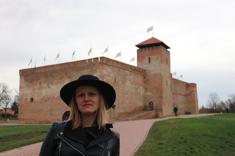 Portrait of beautiful woman against historical building