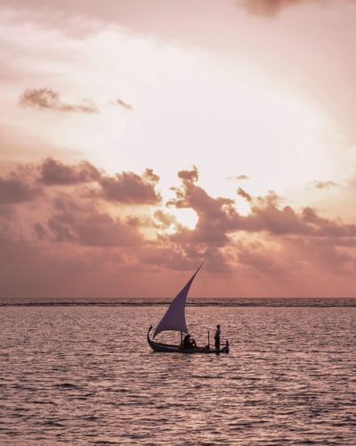 Chasing Sunsets Maldives Sea Sky Sunset Real People Beauty In Nature Scenics - Nature Waterfront Cloud - Sky Nautical Vessel Horizon Tranquil Scene Leisure Activity Transportation Nature Tranquility Men Outdoors Silhouette