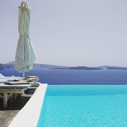 Serenity in Santorini . Andronisluxurysuites ByThePool AndronisExperience Oia Sunbathing Caldera Calderaview NeverWorkFromHomeAnymone