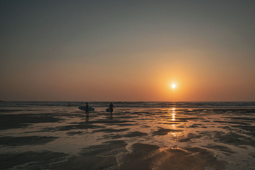 Surf Beach Beauty In Nature Horizon Horizon Over Water Land Lifestyles Nature Orange Color Outdoors People Real People Reflection Scenics - Nature Sea Silhouette Sky Sun Sunset Surface Level Surfing Tranquil Scene Tranquility Water My Best Travel Photo