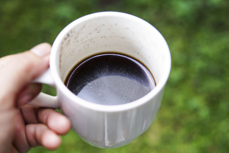Close-Up Of Hand Holding Coffee Cup Outdoors