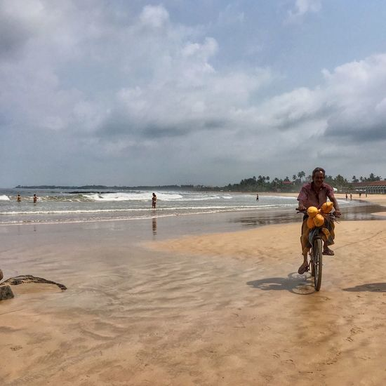 Local People and Lifestyles Sky Cloud - Sky Real People Sea Beach Nature Sand Men Water Bicycle Beauty In Nature Leisure Activity Outdoors Vacations Day Scenics SriLanka Travelling ASIA Travel Destinations
