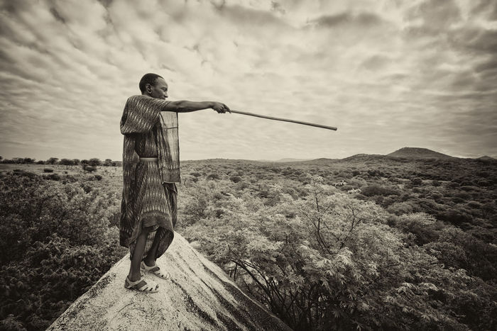 African Guiding Kenya Tanzania Africa Beauty In Nature Black Day Guide Masaai Masai Men Mountain Nature One Person Outdoors People Pointing Real People Rear View Sky Standing Top View Traditional Tribe