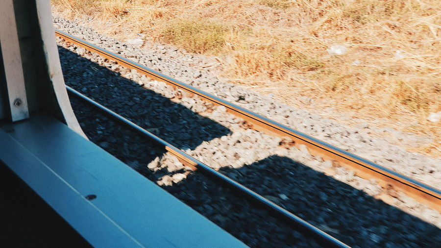 Track Transportation Railroad Track Rail Transportation Day No People Nature Mode Of Transportation High Angle View Water Outdoors Public Transportation Plant Train Metal Close-up Sunlight Window Transparent