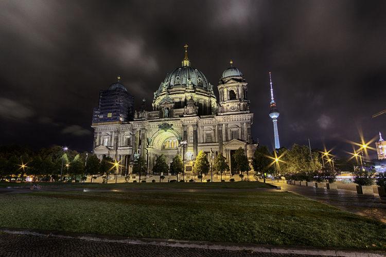 Illuminated berlin dome against sky at night
