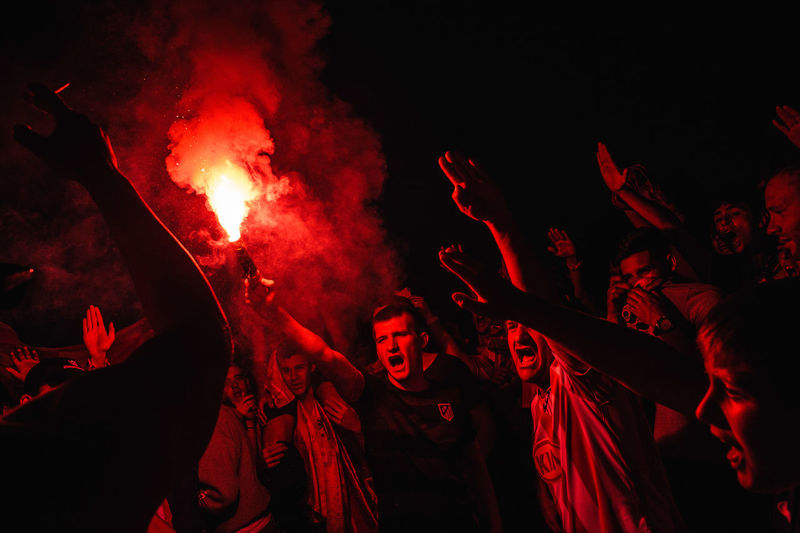 Celebration Football Hooligans Illuminated Large Group Of People Lifestyles Men Night Outdoors People Real People Red Smoke Soccer Sport Summer Togetherness The Photojournalist - 2017 EyeEm Awards