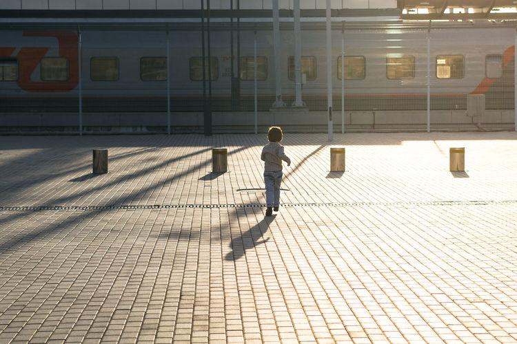 Boy playing on cobblestone