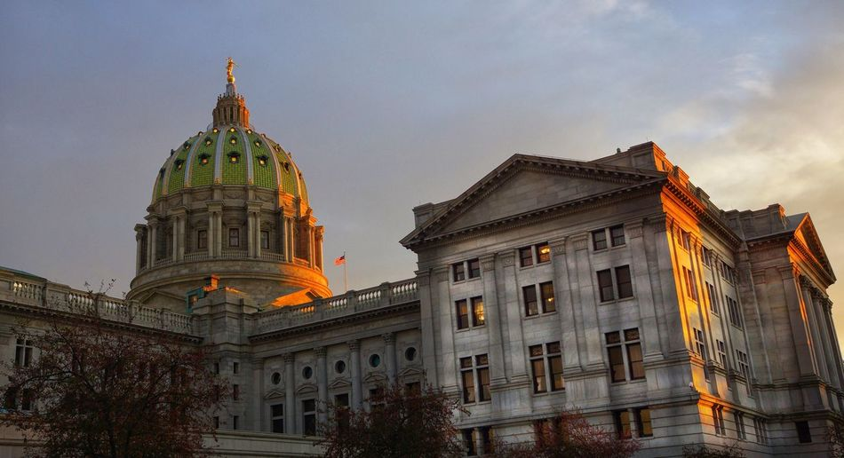 Exterior of pennsylvania state capitol against sky during sunset