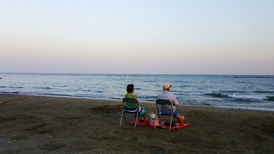 Beach Horizon Over Water Sea Sand Two People Togetherness Sky Water People Rear View Relaxation Tranquility Love Couple Old Age People S6photography Mobile Photography Mobilephotography Cyprus