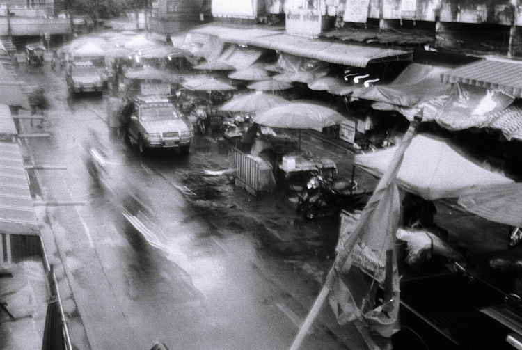 High angle view of people on street in rain