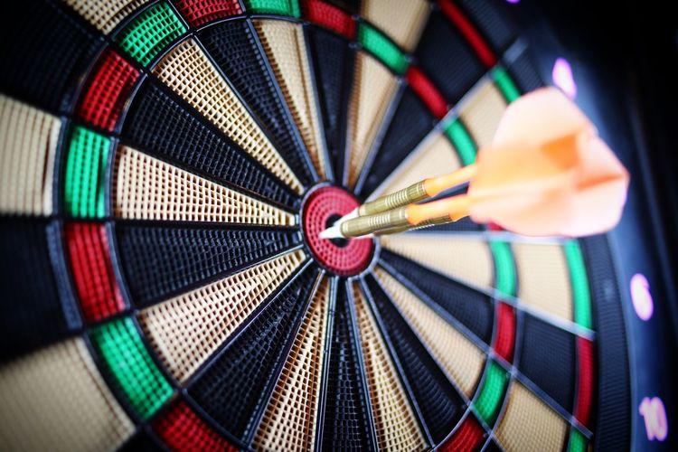 Close-up of arrow on dart board