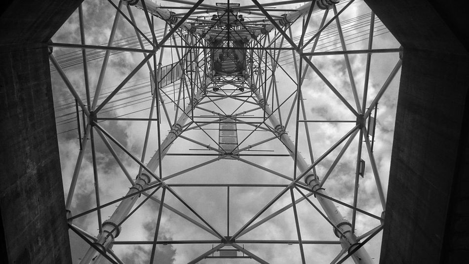 Lookingup Steel Tower  Geometric Shapes Lines Pattern Design Electric Lines Clouds And Sky 鉄塔♡Love Black And White Monochrome Monochrome_Monday EyeEm Best Shots EyeEm Best Edits