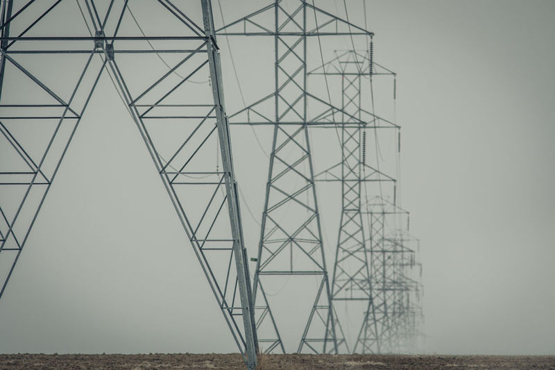 Electricity Pylon Fuel And Power Generation Built Structure Electricity  Connection Sky No People Technology Architecture Power Supply Power Line  Low Angle View Cable Clear Sky Nature Outdoors Metal Tall - High Day Pattern Complexity Electrical Equipment