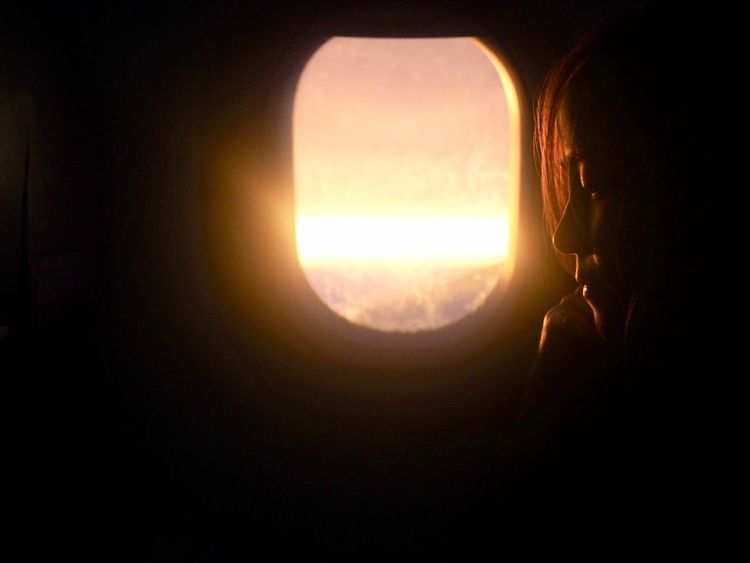 EyeEm New Here Sad Window Seat Airplane Wing Window Seat Airplane Air Window Dark Indoors  Sunlight Sunset Sun One Person