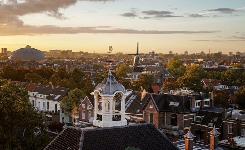 High angle view of church in city against sky during sunset