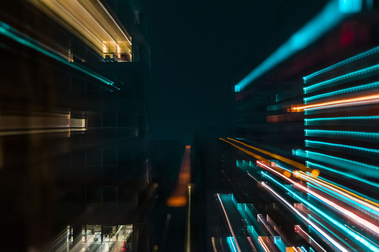 Architecture Blurred Motion Building Exterior Built Structure City City Life Glowing Illuminated Light Light - Natural Phenomenon Light Trail Lighting Equipment Long Exposure Motion Multi Colored Night No People Outdoors Reflection Speed Transportation Zoom Capture Tomorrow 17.62° My Best Photo