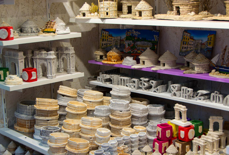 Various souvenir displayed for sale in store