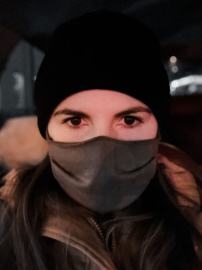 Portrait of mid adult woman in car