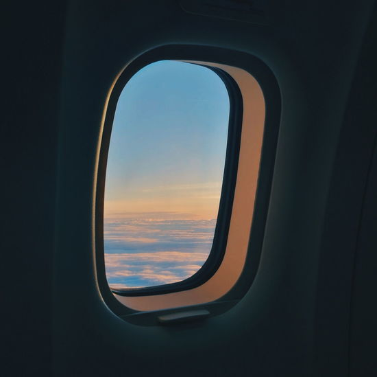 Airplane Commercial Airplane Flying Sunset Aerospace Industry Air Vehicle Business Finance And Industry Window Sunlight Sky Aircraft Wing Plane Skylight Looking Through Window Airplane Wing Silhouette Cloud - Sky Aircraft