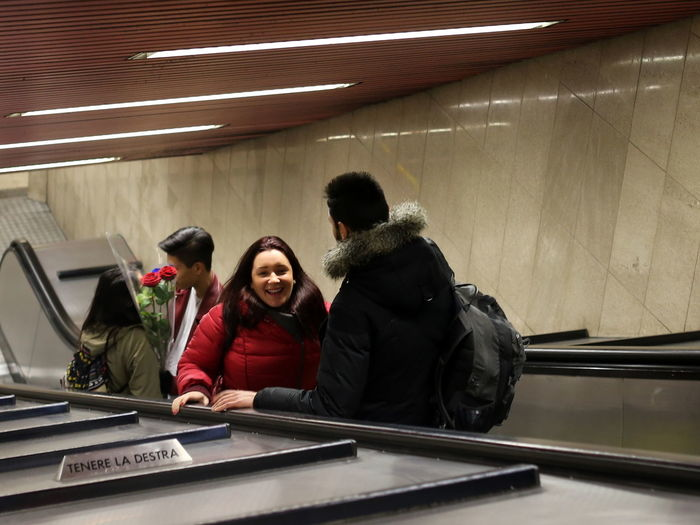 Communication Couple Couple - Relationship Friendship Laughing Love Metro Metro Station Milano People Real People Red Rose Red Roses Roses Standing Streetphotography Togetherness Underground Warm Clothing Young Love Young Lovers Young Women