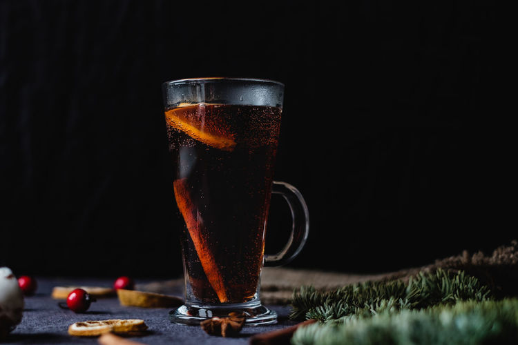 Close up of mulled wine. Warm winter drink still life shot Refreshment Drink Food And Drink Glass Freshness Household Equipment Drinking Glass Food Dark Still Life Mulled Wine Red Wine Christmas Drinks Hot Drink Copy Space