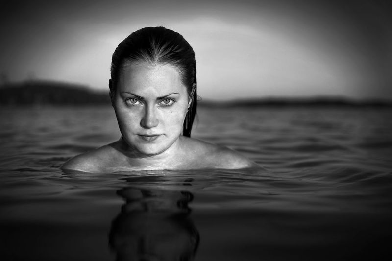 Close-Up Portrait Of Woman In Water