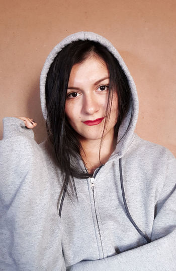 Portrait of young woman wearing hooded shirt