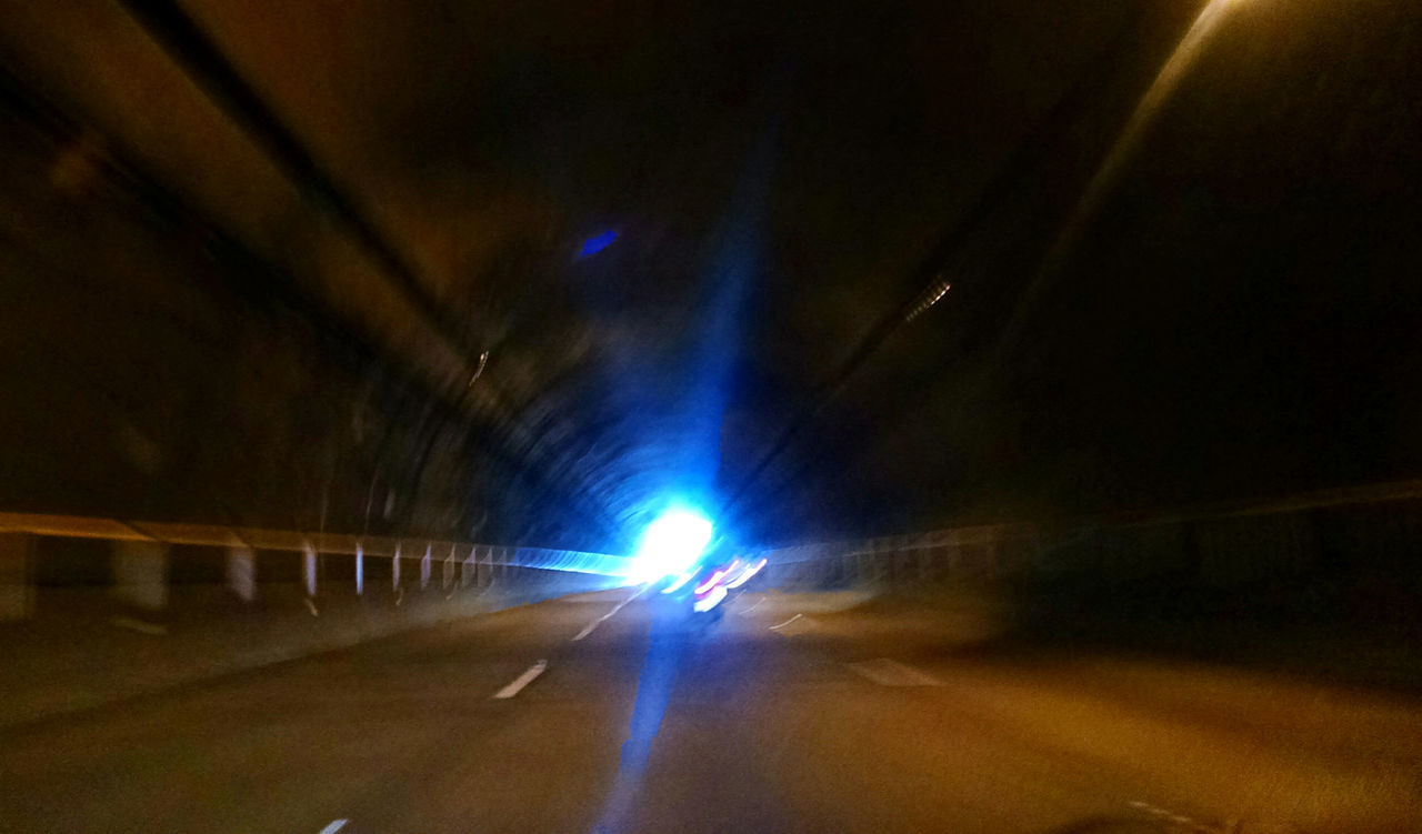 road, illuminated, car, transportation, motor vehicle, direction, the way forward, land vehicle, tunnel, mode of transportation, architecture, lighting equipment, diminishing perspective, no people, night, motion, indoors, light - natural phenomenon, sign, light, light at the end of the tunnel, car point of view, ceiling