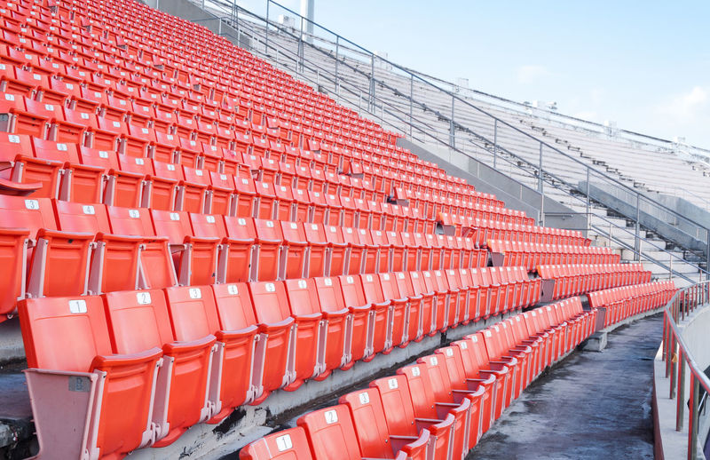 Empty seats in row against buildings