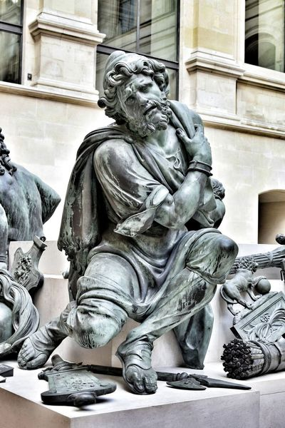 A quick shot of a statue at The Louvre. Architecture Art And Craft Built Structure Close-up Day Human Representation LourveMuseum Male Likeness No People Paris Sculpture Statue The Louvre Museum  Travel Destinations