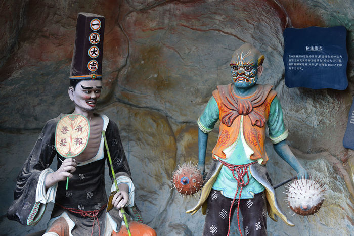 Scenes from Haw Par Villa in Singapore Adult Adults Only Chinese Day Folklore Hell Legends Men Mythology Only Men Outdoors People Singapore Statue Strange Theme Park
